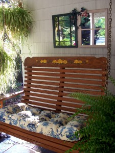 Cozy porch swing for relaxing with your morning coffee