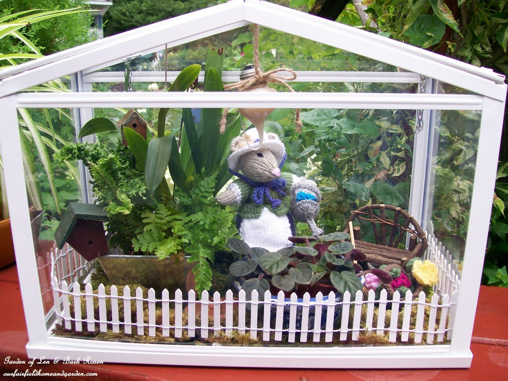 Miss Millicent Mouse in her greenhouse. https://ourfairfieldhomeandgarden.com/featured-artist-bonnie-johnson-fabric-artist/