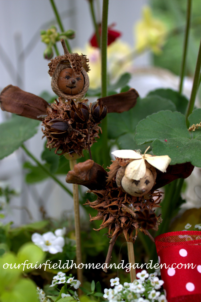 Fairy Plant Pokes https://ourfairfieldhomeandgarden.com/diy-project-making-fairies-from-natural-materials/