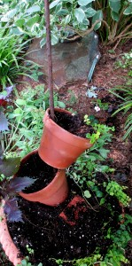 planter diy https://ourfairfieldhomeandgarden.com/diy-project-build-your-own-tipsy-pots-planter/