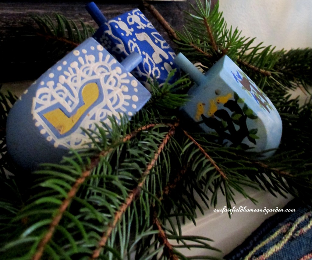 hand painted dreidels https://ourfairfieldhomeandgarden.com/its-beginning-to-look-a-lot-like-chanukah/
