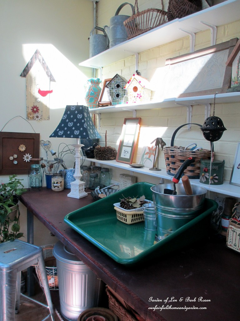 potting bench work space https://ourfairfieldhomeandgarden.com/my-winter-sanctuary-scenes-from-a-garden-room/
