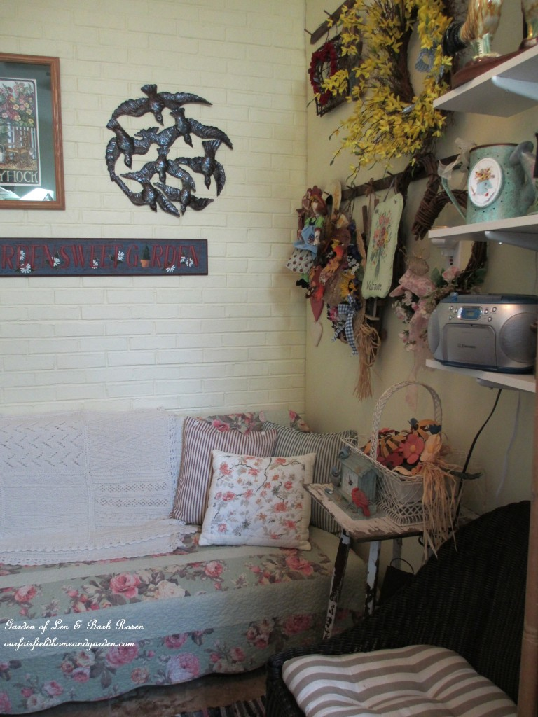 quilt-covered futon for resting & reading http://ourfairfieldhomeandgarden.com/my-winter-sanctuary-scenes-from-a-garden-room/