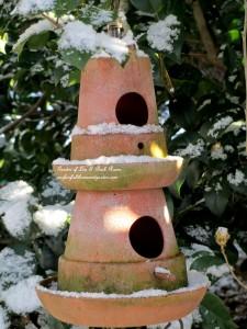 Double-decker birdhouse https://ourfairfieldhomeandgarden.com/january-winter-garden/