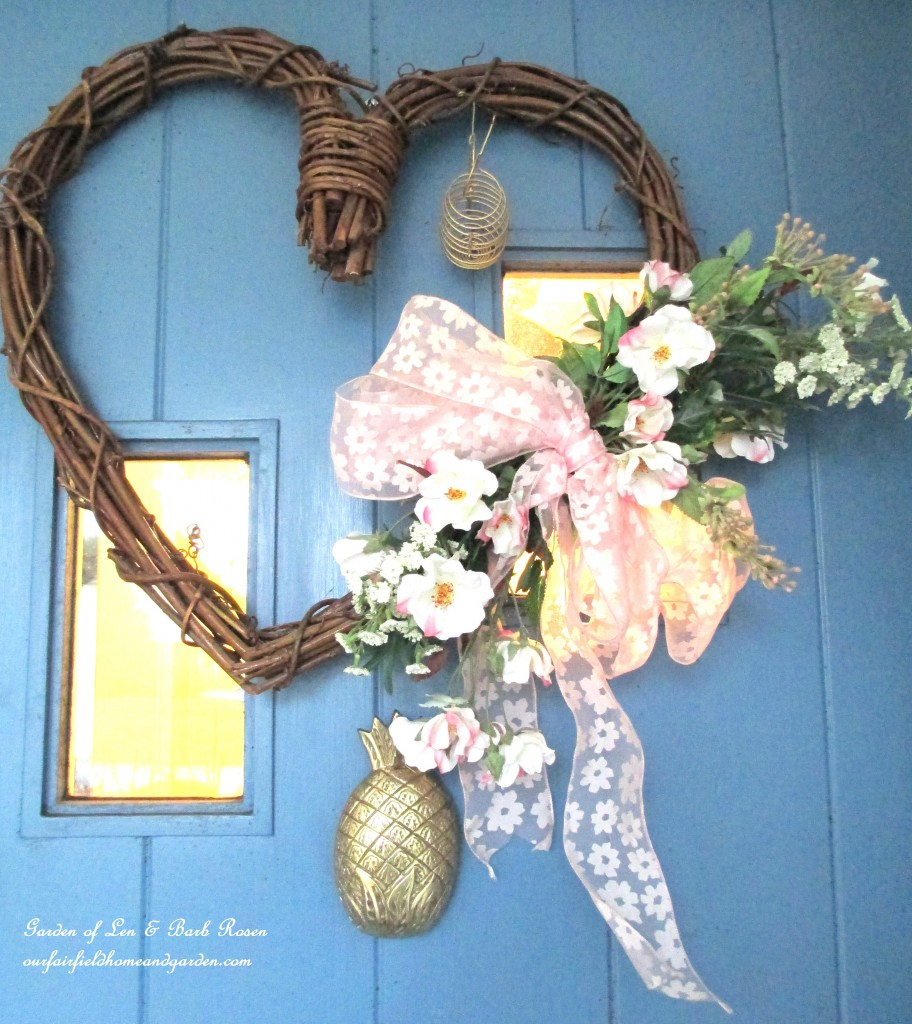 Valentine's wreath on the front door https://ourfairfieldhomeandgarden.com/heart-home-valentines-day-is-coming/