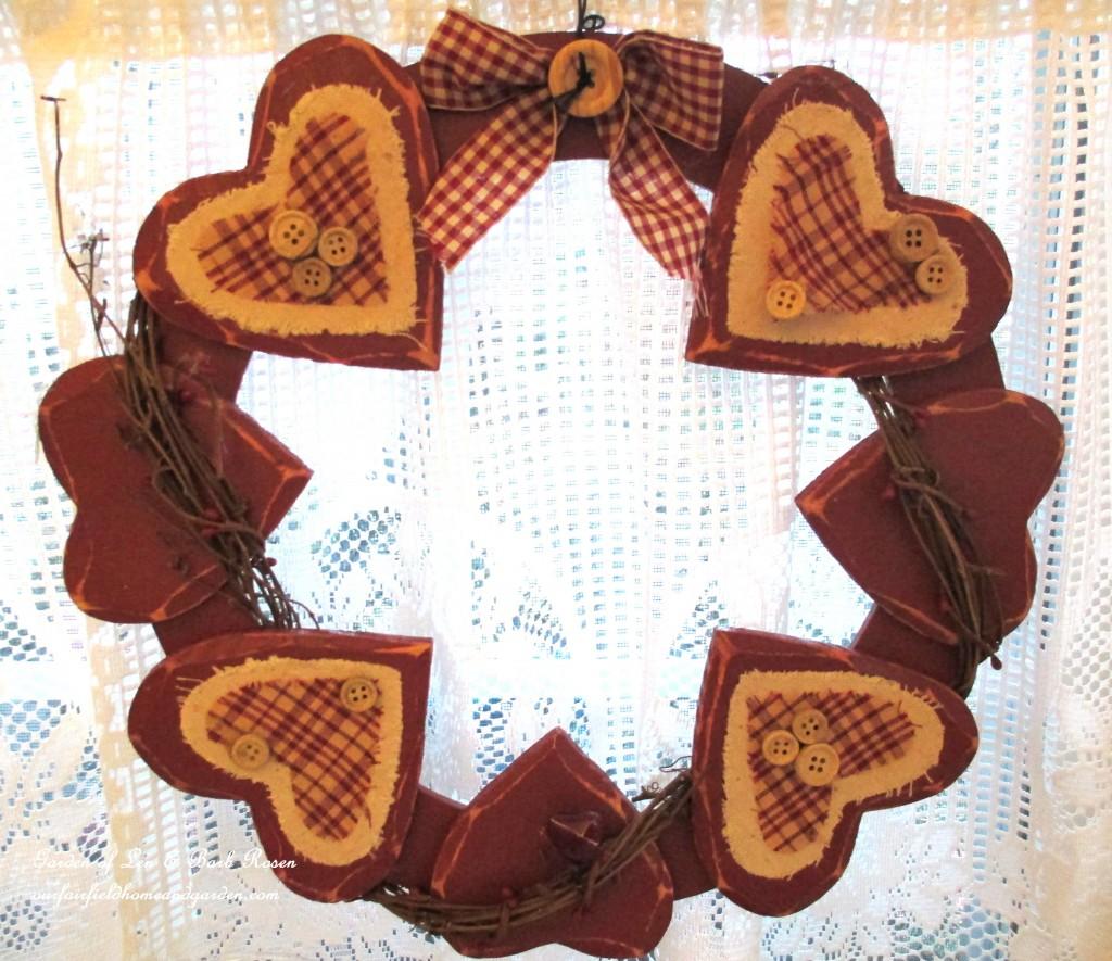 wreath of hearts in the kitchen window https://ourfairfieldhomeandgarden.com/be-my-valentine-valentine-decor/
