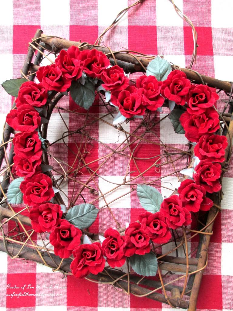 heart wreath on a red & white checked runner https://ourfairfieldhomeandgarden.com/be-my-valentine-valentine-decor/