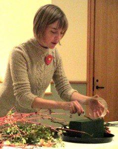Emily demonstrates cutting the floral oasis.