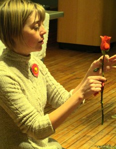 Emily removes the first few outer petals on each rose to freshen them up.