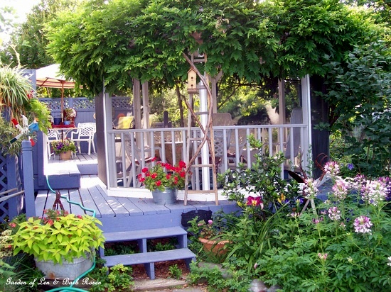 Gazebo & back deck in summer https://ourfairfieldhomeandgarden.com/a-trip-down-memory-lane-my-former-garden/