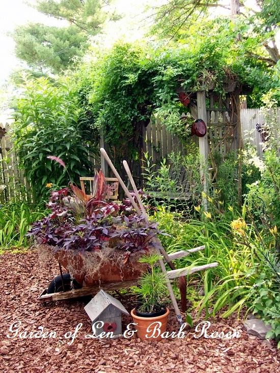 Wheelbarrow planting https://ourfairfieldhomeandgarden.com/a-trip-down-memory-lane-my-former-garden/