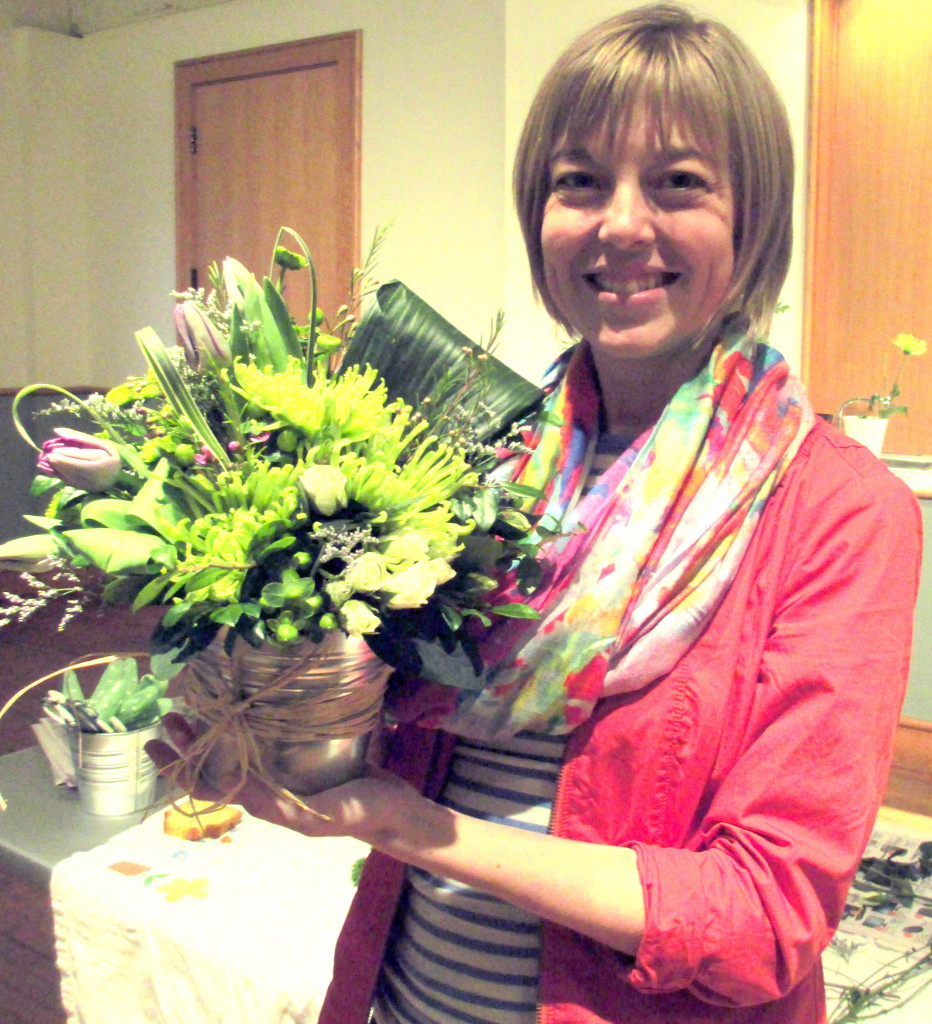 "Emily Smith with her ""Easy to be Green"" floral arrangement."