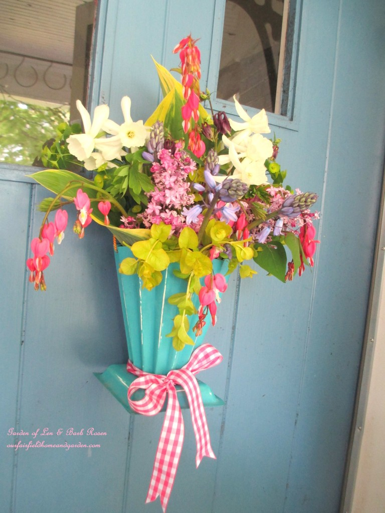 Hang a May Day Basket on your door instead of a wreath! https://ourfairfieldhomeandgarden.com/diy-project-gather-flowers-for-a-may-day-basket/