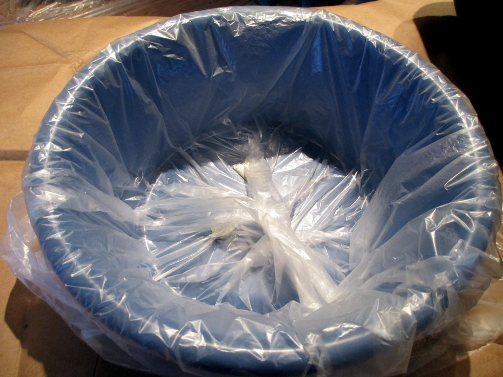 Step #  ~ Slip the container into a plastic trash bag