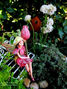 Tulip Fairy in her birdbath garden https://ourfairfieldhomeandgarden.com/diy-project-mothers-day-fairy-garden/