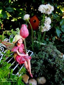 Tulip Fairy in her birdbath garden http://ourfairfieldhomeandgarden.com/diy-project-mothers-day-fairy-garden/