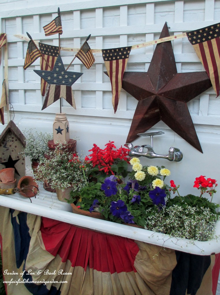Red, white and blue flowers in the potting sink! https://ourfairfieldhomeandgarden.com/happy-4th-of-july-patriotic-potting-sink/