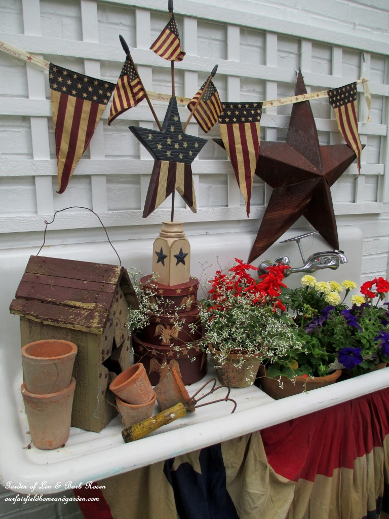 The Fourth of July dressing of our vintage potting sink. https://ourfairfieldhomeandgarden.com/happy-4th-of-july-patriotic-potting-sink/