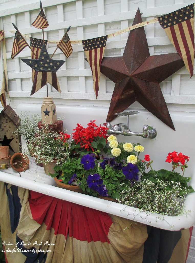 Tea stained banner and drape for a vintage sink. https://ourfairfieldhomeandgarden.com/happy-4th-of-july-patriotic-potting-sink/