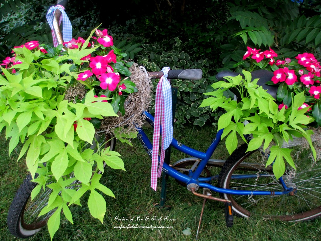 My completed bicycle planter complete with ribbon streamers!https://ourfairfieldhomeandgarden.com/diy-project-my-bicycle-planter/