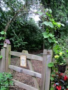 the back gate arbor https://ourfairfieldhomeandgarden.com/garden-walk-my-summer-garden/