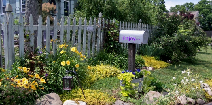 A picket fence planting from Magic Touch & Her Gardens
