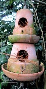 Terra Cotta Birdhouse https://ourfairfieldhomeandgarden.com/its-all-about-the-birds-birdfeeders-birdbaths-and-birdhouses-in-our-garden/