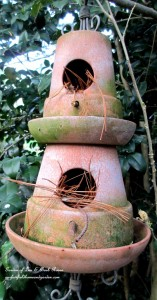 Terra Cotta Birdhouse http://ourfairfieldhomeandgarden.com/its-all-about-the-birds-birdfeeders-birdbaths-and-birdhouses-in-our-garden/