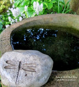 Stone Birdbath http://ourfairfieldhomeandgarden.com/its-all-about-the-birds-birdfeeders-birdbaths-and-birdhouses-in-our-garden/