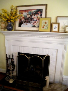 artwork placed on the mantel http://ourfairfieldhomeandgarden.com/livingroom-makeover-grandma-to-grandeur/