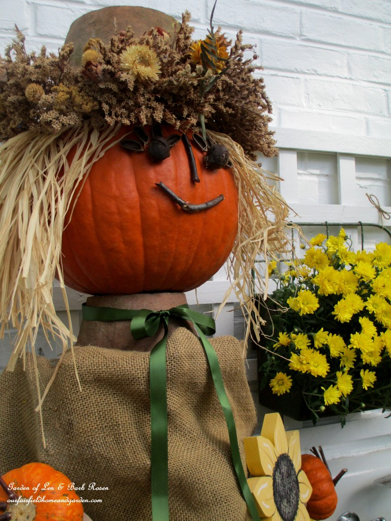 Pumpkin Lady with seed pods and twigs glued on for her face! https://ourfairfieldhomeandgarden.com/fall-is-in-the-air/