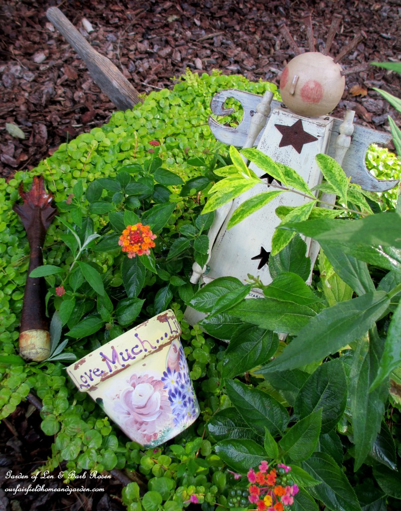 Garden Angel in a planted wheelbarrow. https://ourfairfieldhomeandgarden.com/fall-is-in-the-air/
