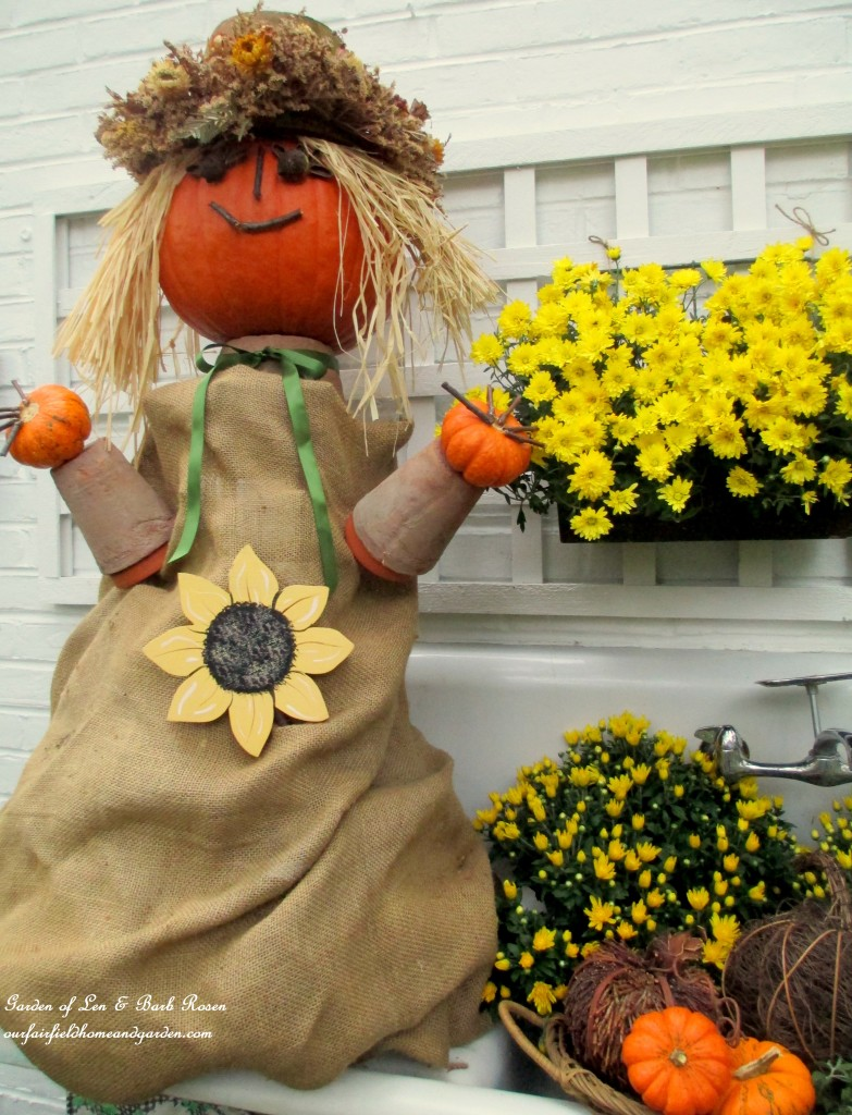Pumpkin Lady with burlap dress, flower pot arms and gourd head https://ourfairfieldhomeandgarden.com/fall-is-in-the-air/and hands.