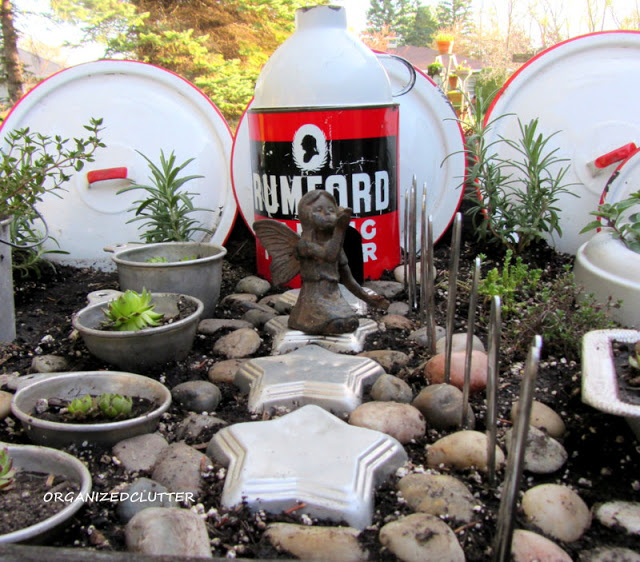 Here's an imaginative kitchen themed fairy garden from Carlene at Organized Clutter! Click through for all the details!