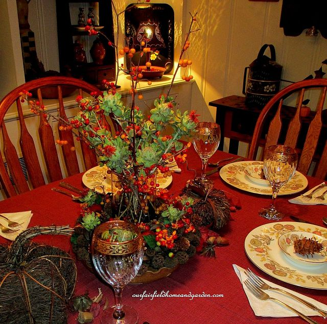 Thanksgiving Table decorated with Fall seed pods and bittersweet https://ourfairfieldhomeandgarden.com/autumn-garden-accents-inside-and-out/