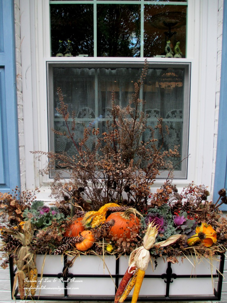 Fall Window Box using seasonal gourds, ornamental kale, Indian corn and dried seed pods & flowers from the garden.
