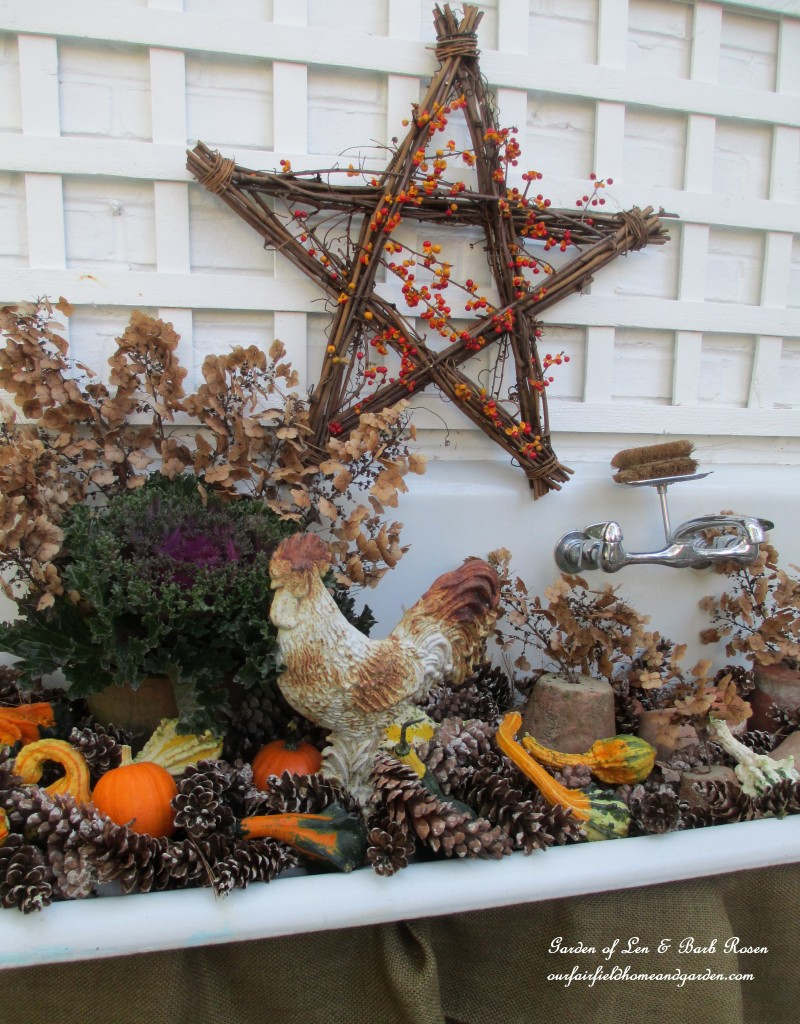 Fall Potting Sink filled with gourds, pinecones, kale and flowerpots. https://ourfairfieldhomeandgarden.com/autumn-garden-accents-inside-and-out/