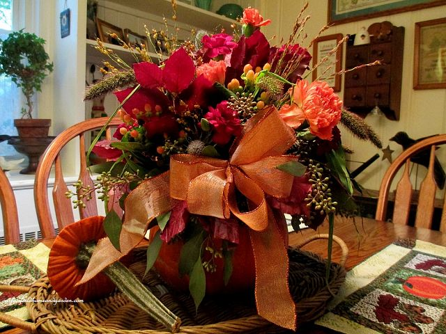 Floral Pumpkin Centerpiece https://ourfairfieldhomeandgarden.com/autumn-garden-accents-inside-and-out/