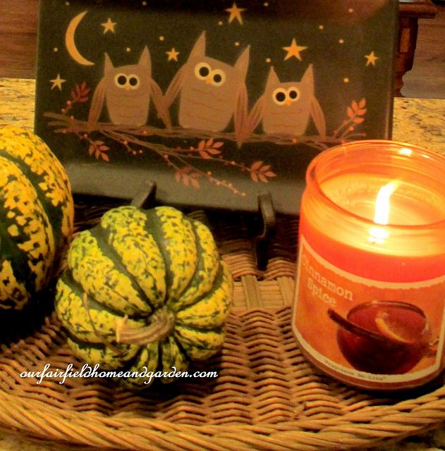Little owl tray, gourds and a scented candle in our Fall kitchen. https://ourfairfieldhomeandgarden.com/autumn-garden-accents-inside-and-out/