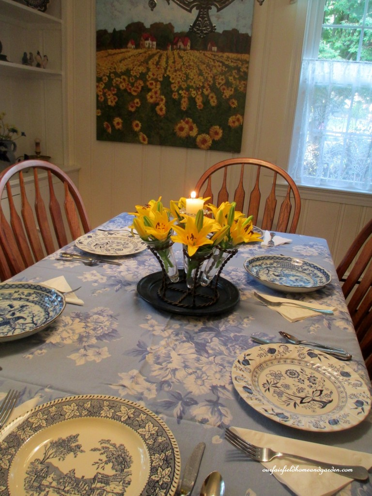 blue & white table setting  https://ourfairfieldhomeandgarden.com/restaging-our-country-french-dining-room/