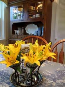 yellow lilies centerpiece  http://ourfairfieldhomeandgarden.com/restaging-our-country-french-dining-room/