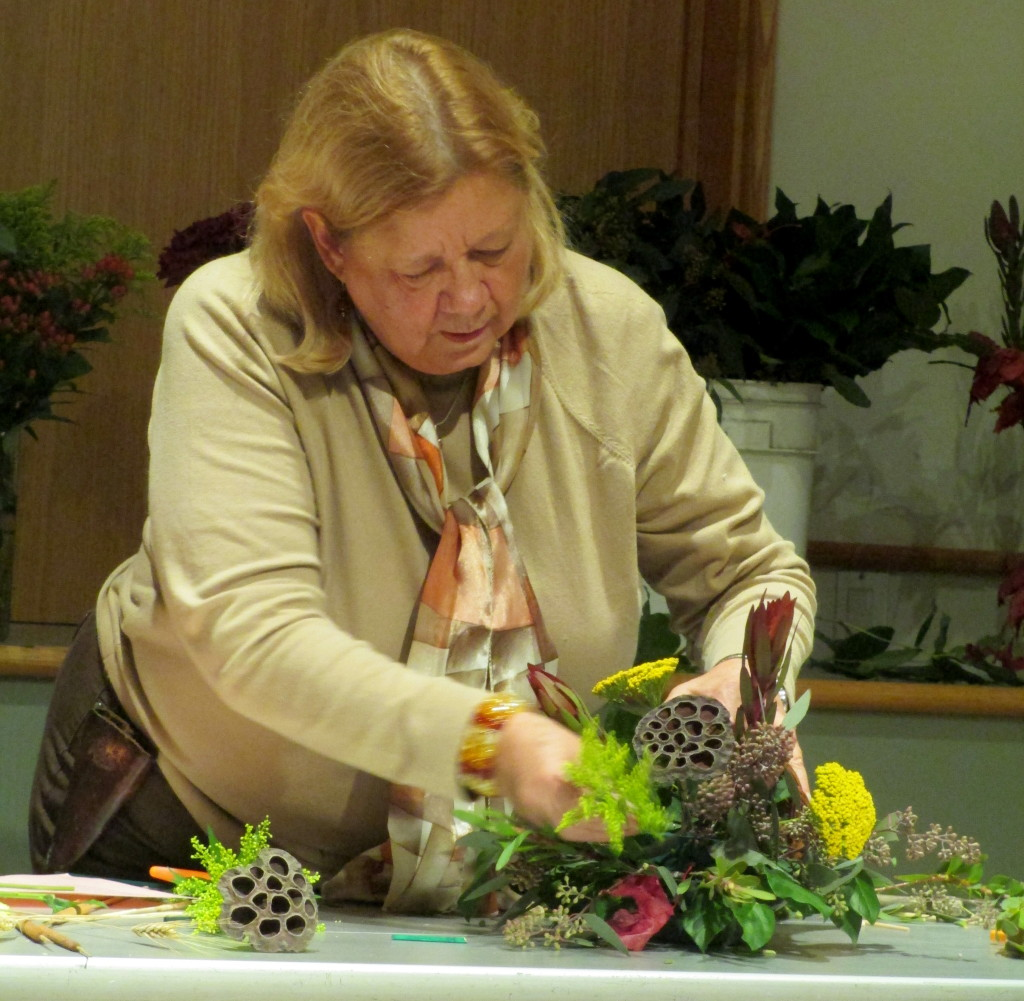 Brenda Tunis demonstrating the steps in constructing a floral cornucopia.