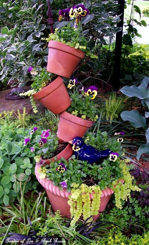 Tipsy Planter Pots http://ourfairfieldhomeandgarden.com/spring-fever/