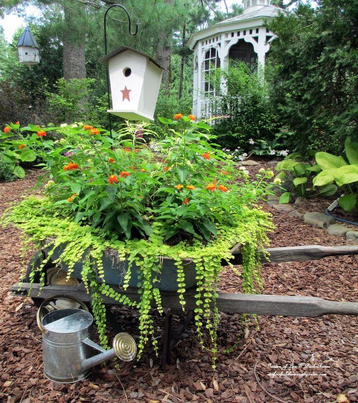Planted Wheelbarrow https://ourfairfieldhomeandgarden.com/garden-walk-my-summer-garden/