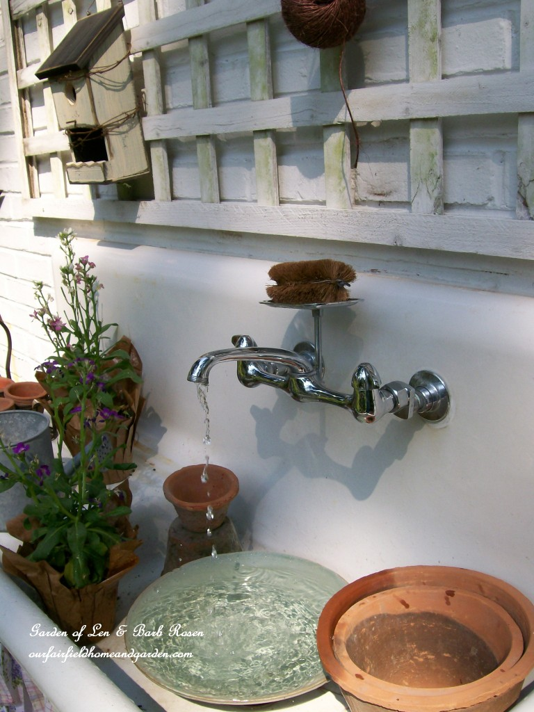 Kitchen Sink Fountain and Potting Bench https://ourfairfieldhomeandgarden.com/everything-including-the-kitchen-sink/