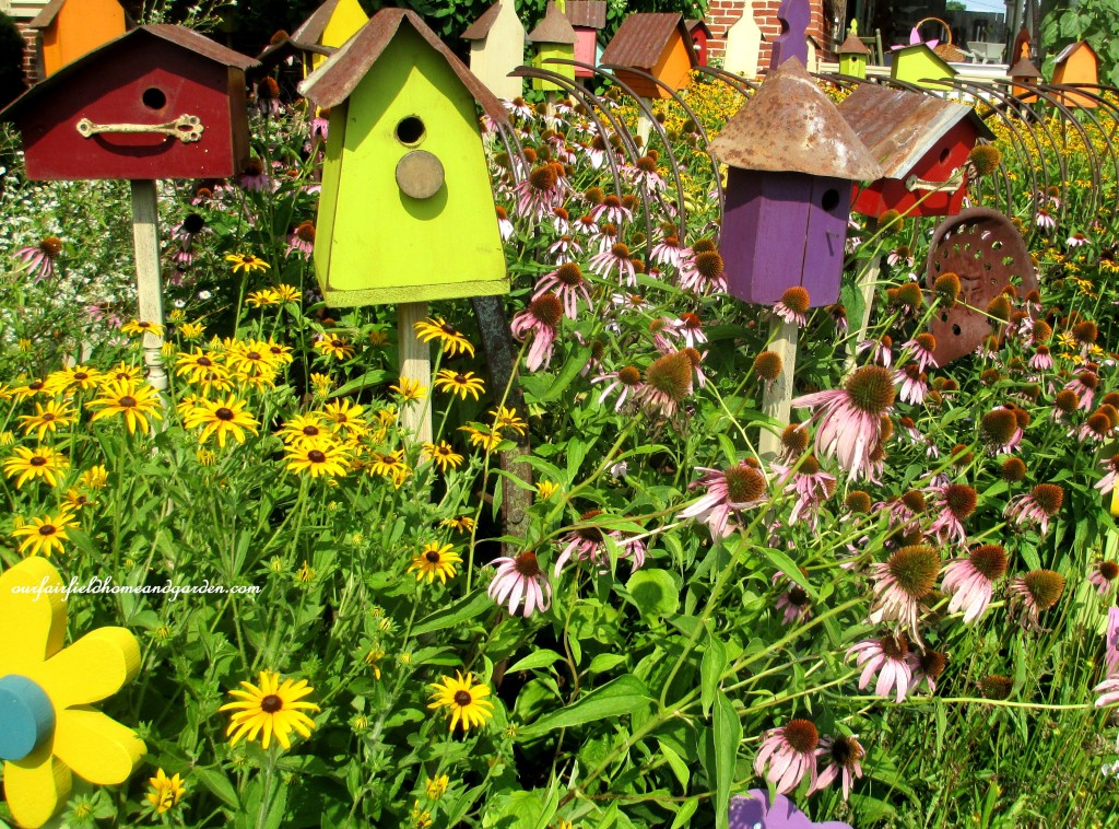 Birdhouses & Flowers http://ourfairfieldhomeandgarden.com/field-trip-potting-bench-from-a-dresser-and-other-ideas-gathered-in-lancaster-county-pa/