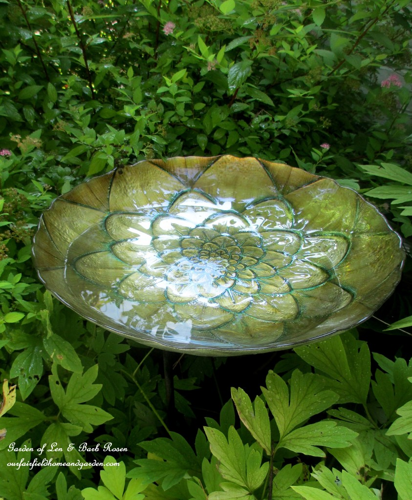 Decorative Dish Birdbath https://ourfairfieldhomeandgarden.com/diy-bird-baths-bring-birds-to-your-garden/