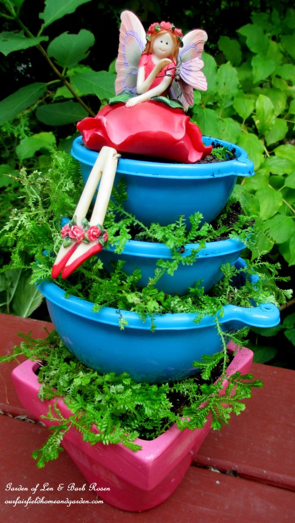 Tiered Funnel Planter http://ourfairfieldhomeandgarden.com/kitschy-kitchen-garden-accents/