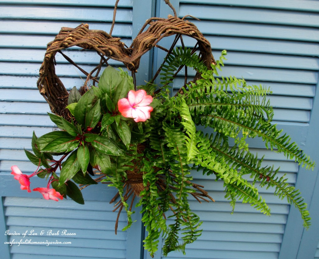 Planted Heart Basket https://ourfairfieldhomeandgarden.com/salvaged-the-32-shutter-challenge-repurposing-shutters-in-the-garden/