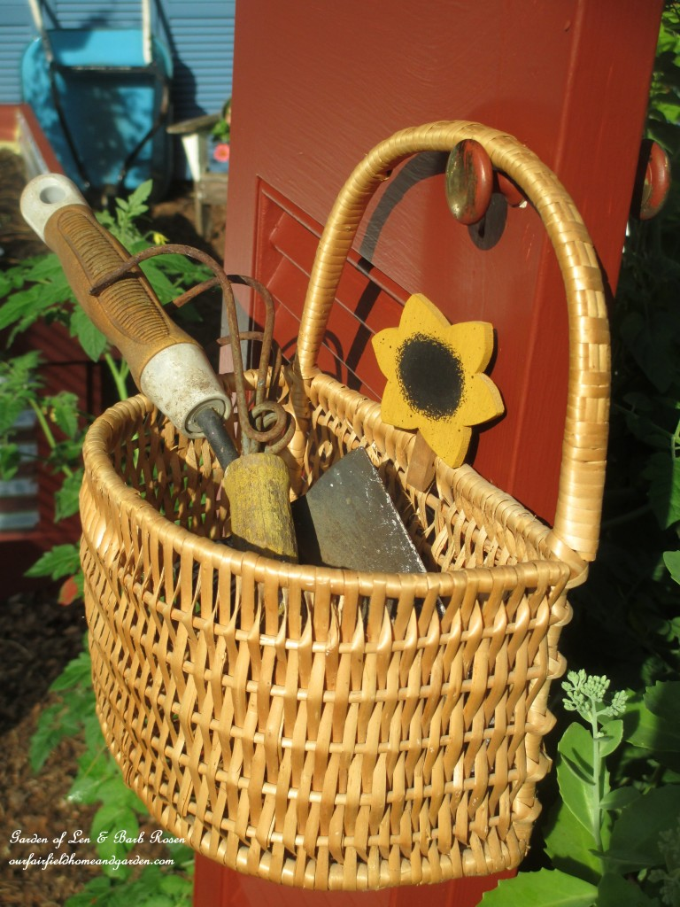 Tool Basket https://ourfairfieldhomeandgarden.com/salvaged-build-a-shutter-arbor/